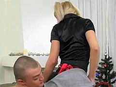 Pigtailed blond sweetie strokes and sucks a massive dick